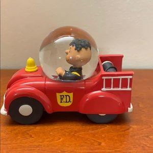 Hallmark peanuts Franklin fire truck snow globe